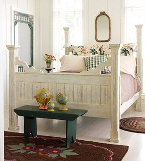 Old & New - A whitewashed bed frame and painted bench mix with pretty new bedding to create a welcoming haven in a renovated farmhouse. An old painted screen door takes the place of a traditional closet door.