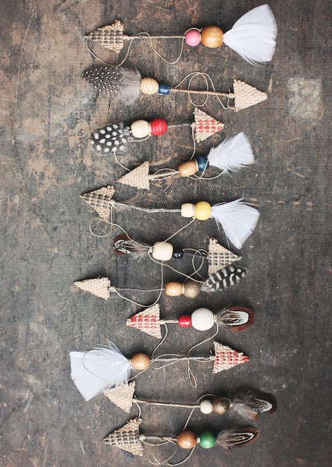 Take a more bohemian approach with your ornaments by making arrows with twigs, feathers, and wooden beads.