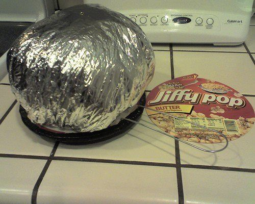 NOSTALGIA - JIFFY POP Popcorn Shake Pan On A Stove Top Burner and watch the Aluminum Balloon rise up as the popcorn popped inside.: