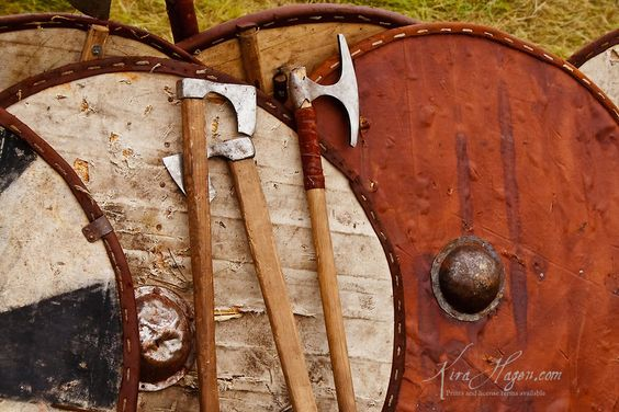 Viking period shields and axes lean against a tent wall