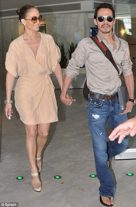 Co-ordinated: Jennifer Lopez and Marc Anthony leaving their luxury hotel in La Concha, in Condado, Puerto Rico