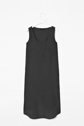 SILK AND COTTON DRESS    Made from a soft blend of silk and cotton, this lightweight dress has panel detail and a small chest pocket. A loose fit, it is sleeveless with a low round neckline. It has a curved hemline with split side seams.  Length: 116cm (size S)