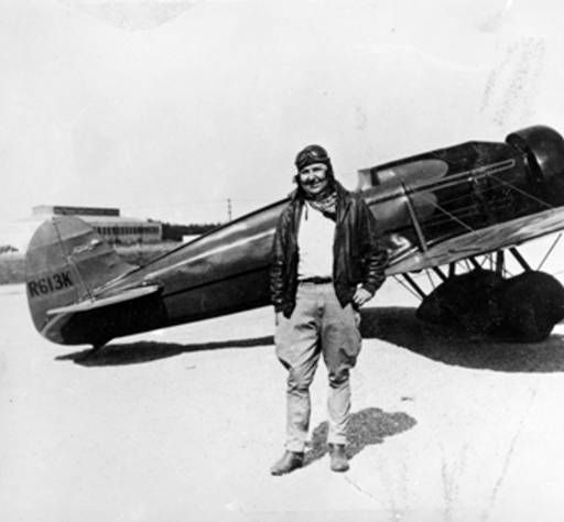 "Florence ""Pancho"" Barnes with her Len Travel Air Mystery S., August 4, 1930. On that day, Barnes set a new speed record for women of 196.19 miles per hour. She is also known for setting other flying records, racing planes, working in the Hollywood film industry, and organizing the stunt pilots union during the Depression. San Fernando Valley History Digital Library."