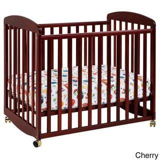 Davinci Alpha Mini Rocking Crib Red Cherry Finish Cribs Cribs For Small Spaces Mini Crib