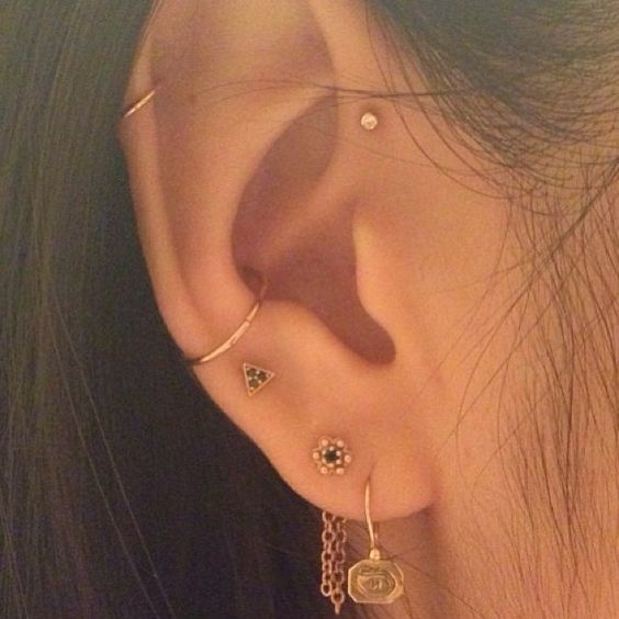 Orbital conch, upper lobe, lobes, cartilage and forward helix piercing. J Colby Smith earrings