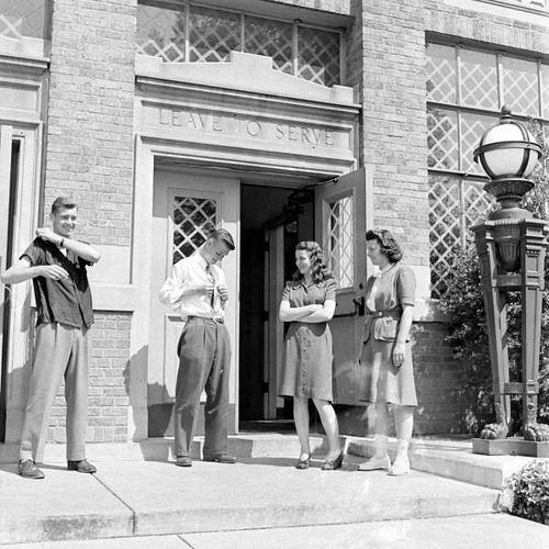 Boys are trying to look good to impress the girls. Missouri, 1940s