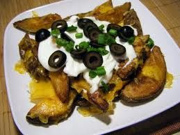 Baked Potato Nachos 4 potatoes baked after they have cooled, slice into 12 inch rounds Brown 1 pound of ground beef and season with your favorite seasoning Top each potato round with ground beef and shredded cheese bake until cheese has melted then top with onions, tomatoes, black olives, guacamole and or sour cream. Really good alternative to chips and loaded with potassium. Yummy too!