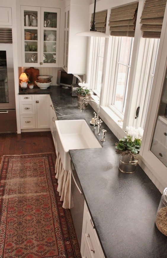 I get a lot of questions asking about my experience with the soapstone countertops in the kitchen. The soapstone questions run a close second to the questions I get asked about marble, which I wrote