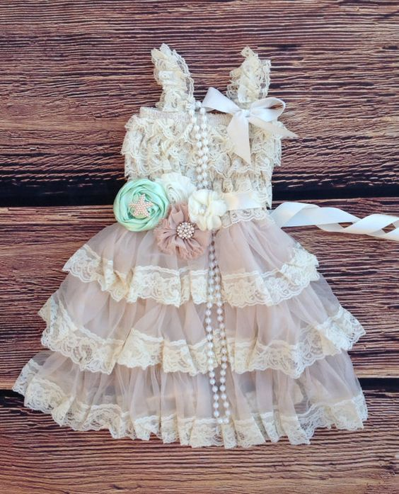 2pc Set: Includes- Dress/Sash/. Rustic simplicity at its finest! The dress is made of beautiful beige soft stretchy lace on top with lace