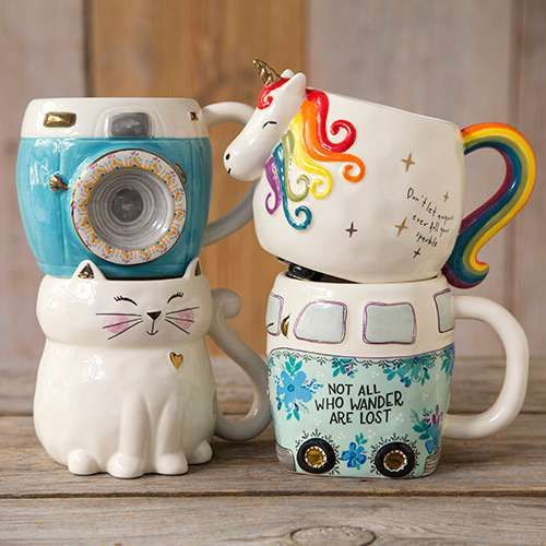 This folk mug will have you smiling every time you drink from it! Hand sculpted, ceramic mug is microwave and dishwasher safe wiith a cute and playful design.