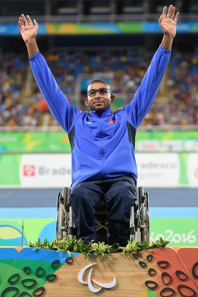 Gold medalist Walid Ktila of Tunisia celebrates on the podium at the medal ceremony for the Men's 100m - T34 Final on day 5 of the Rio 2016 Paralympic Games at the Olympic Stadium on September 12, 2016 in Rio de Janeiro, Brazil.