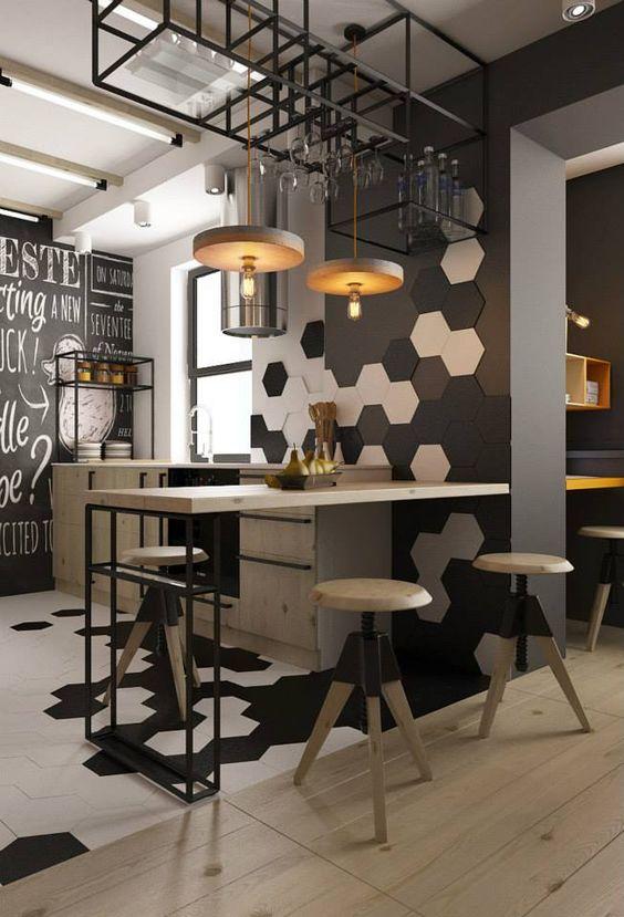 Cuisine style industriel, avec à l'honneur les Céramiques héxagonales, les avoir en négatif donne un coté très graphique.