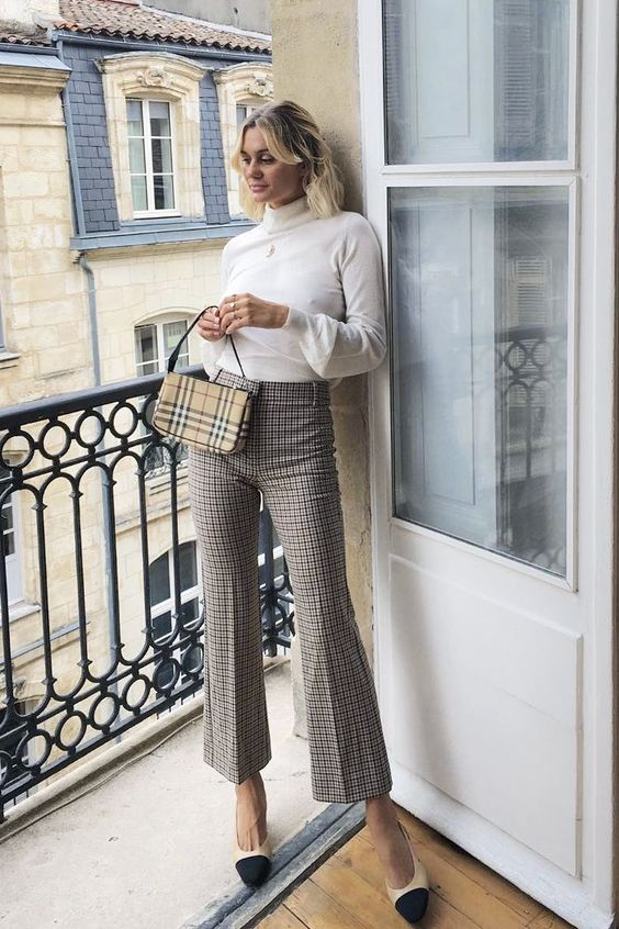 French autumn outfits: Anne Laure wearing checked trousers and roll neck