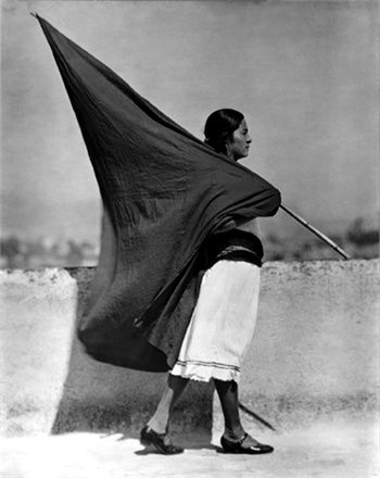 photo of woman carrying a flag