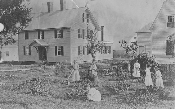 Girls tending the garden, In the foreground is the Ministry Shop and to the right is the Meetinghouse; Shaker Village, Canterbury, NH