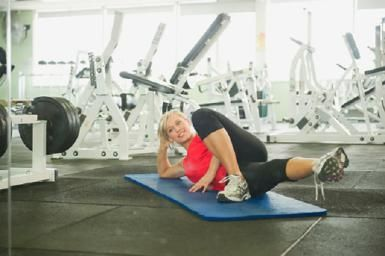 How To Do Inner Thigh Lifts to Firm and Tone: Woman stretching in gymnasium