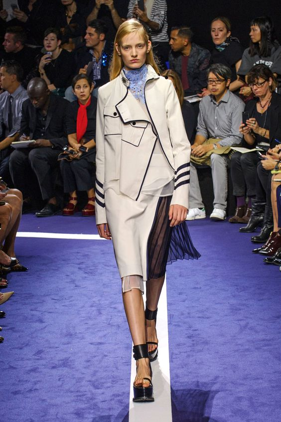 Elsewhere, an admiral's coat was turned into a moto jacket and then worn with a sheer black pleated skirt or lacy mini.  Imaxtree  - HarpersBAZAAR.com