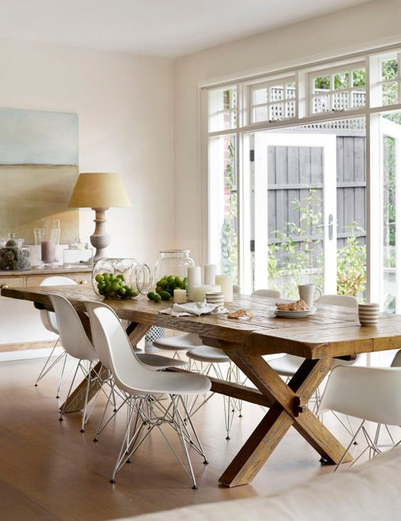 Dining Room mix. Rustic table with fiberglass chairs. Toby Scott.