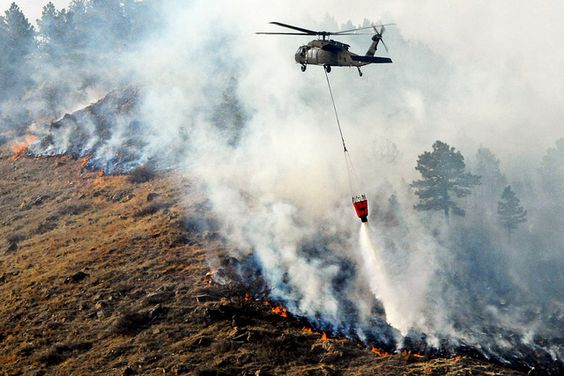 A South Dakota Army National Guard UH-60 Black Hawk helicopter drops 600 gallons of water on a fire in Rapid City, South Dakota, March 9, 2012. The helicopter crew is assigned to the Army National Guard Aviation Support Facility. U.S. Army photo by Master Sgt. Don Matthews.  #ArmyAviation