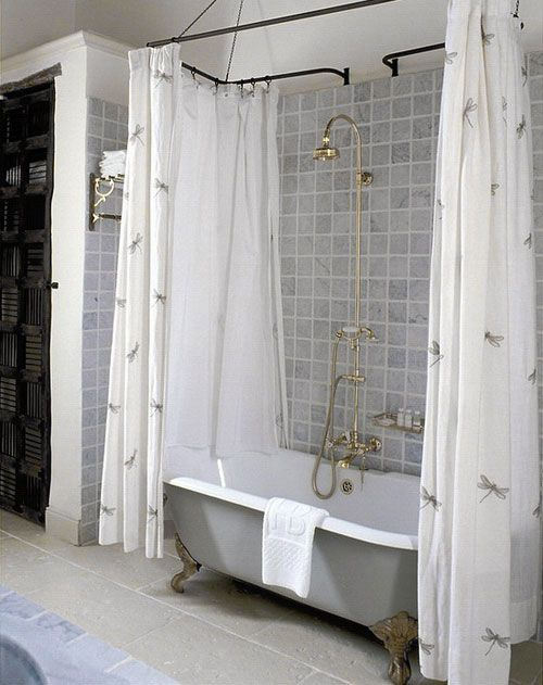 """98. Need extra shower/tub storage? Add a second curtain rod to the back of your shower or tub. Use some """"S"""" shaped shower curtain hooks to hang loofahs, and wash clothes. You can also buy some cheap baskets at the dollar store to hang from the hooks. Perfect for storing things like kids tub toys and Shampoo bottles."""