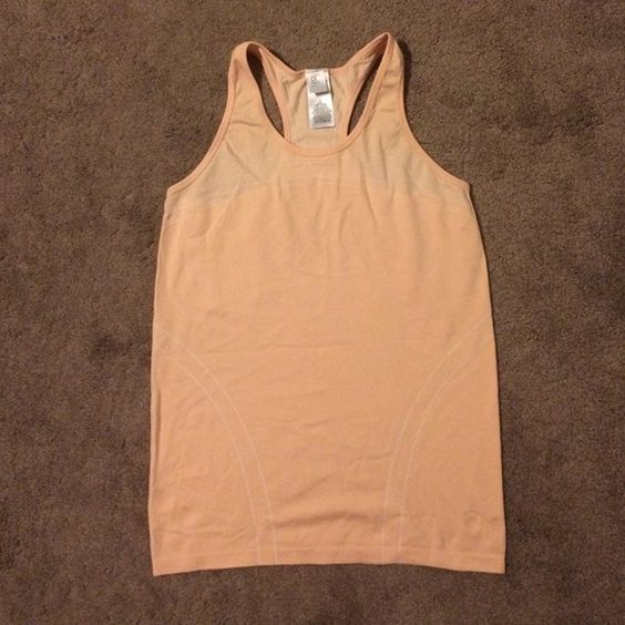 GapFit Motion Racerback Tank GapFit Racerback Tank in peach color. Looks just like Lululemon when wearing! DriFit fabric. Perfect for summer. GAP Tops Tank Tops