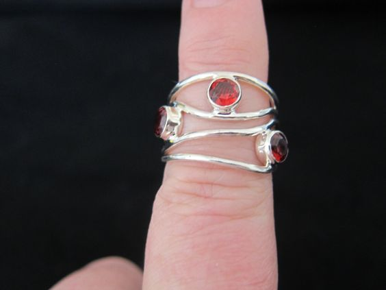 A personal favorite from my Etsy shop https://www.etsy.com/listing/245077553/garnet-sterling-silver-ring-size-8