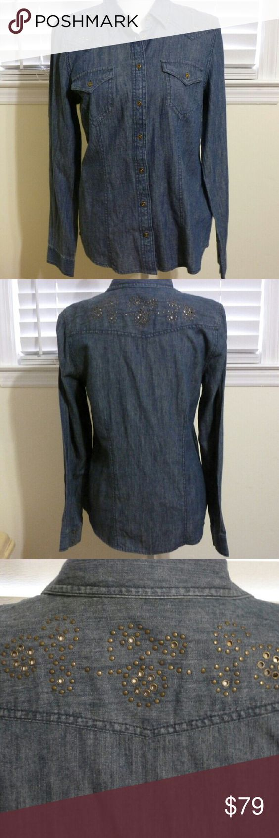 Nine West Vintage American Denim Shirt A little western,  a little bling and a lot of cute.  This Nine West denim shirt is 100% cotton and new with tags. Some of the metal grommets are peek a boo style. Nine West Tops Button Down Shirts