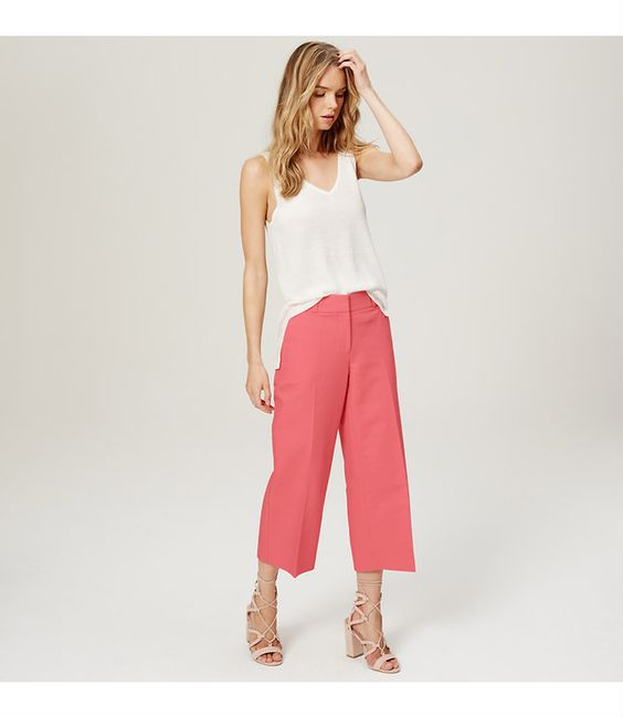 "Crisply cut in a cropped wide-leg fit and splashed with a sweet hue, these pants exude getaway chic. Your perfect fit if your hips are proportionate to your waist. Zip fly with hook and bar closure. Belt loops. Slash pockets. Back welt pockets. 24 1/2"" inseam."