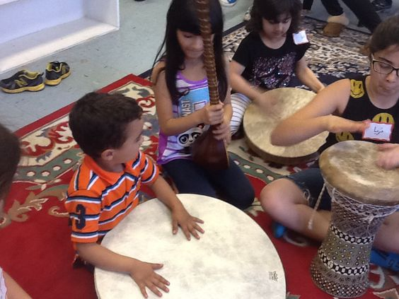 Learning about Persian traditional music and instruments class for children taught by Roshanak Keyghobadi