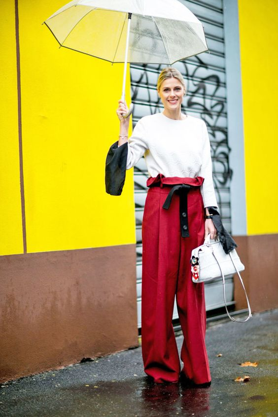 slouchy red trousers look perfect paired with a white top and tote