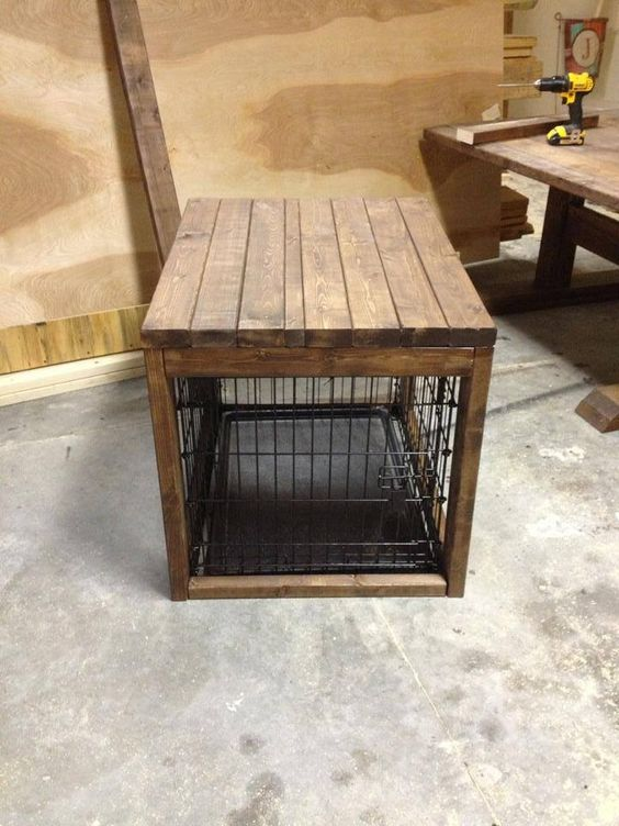 Dog cage with a table built over it