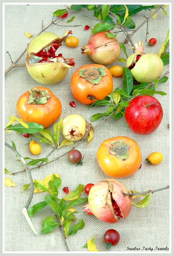 A simple and beautiful salad made with seasonal bounty- Apples,Persimmon, Cherry Tomatoes and Poms, an alternative to Thanksgiving Mash