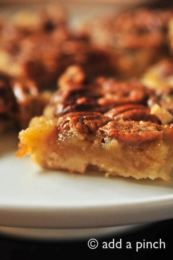 "Southern pecan pie bars. ""Light, flaky, shortbread crust topped with pecan pie."