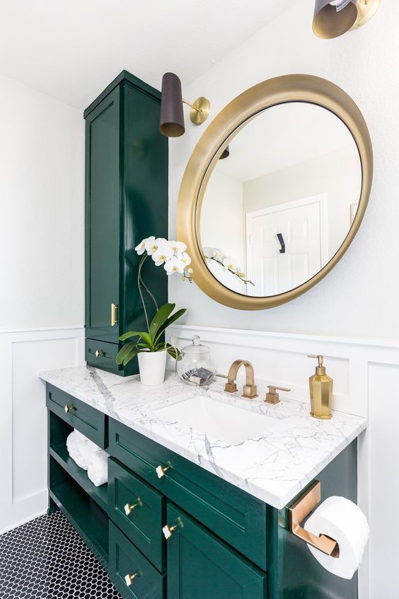 A Stunning Emerald And White Stone Bathroom Spruced Up With Gold Hardware And A Large Round Mirror Gold Bathroom Fixtures Bathroom Makeover Bathrooms Remodel