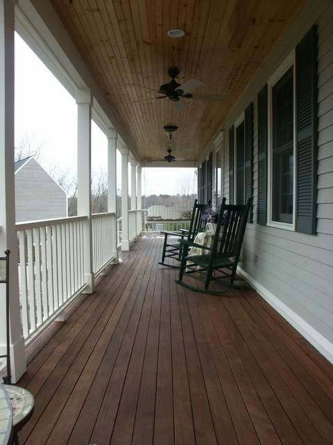 Classic New England farmer's porch with knotty pine ceiling and mahogany decking