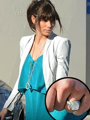 Jessica Biel's ring — which she's rarely flashed in public since her and Justin Timberlake's engagement was announced in January — features a large, slightly rounded square-cut diamond with smaller stones surrounding it, and appears to have a vintage feel.