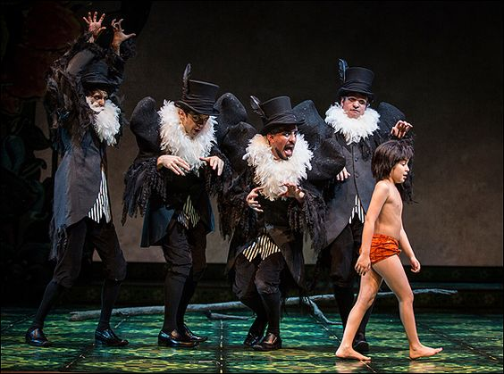 """The Jungle Book"" at Chicago's Goodman Theater, costumes by Mara Blumenfeld. Instead of dressing the people like animals, they wear clothes that suggest the animals' personalities. Brilliant!"