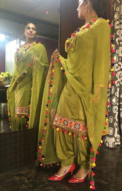 Punjabi Salwar Suit In Beautiful Mehendi Color Semi Stitched Silk Fabric With Pom Pom Patiala Suit Designs Punjabi Outfits Indian Designer Suits