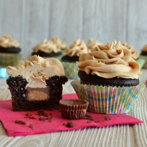 Chocolate cupcakes with peanut butter cup centers and peanut butter frosting. I think my husband would LOVE these!