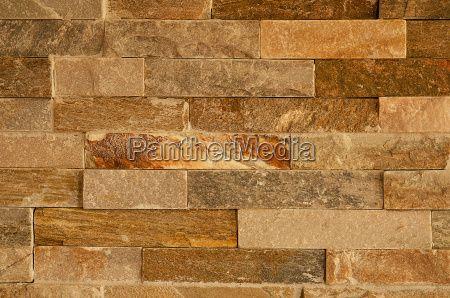 #lng_pintrest_desc# 11759927 - hintergrund fassade naturstein riemchen verblender