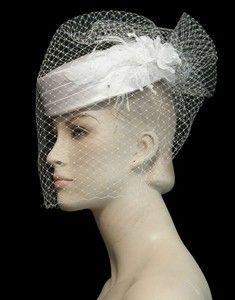 Birdcage veil with pillbox hat.