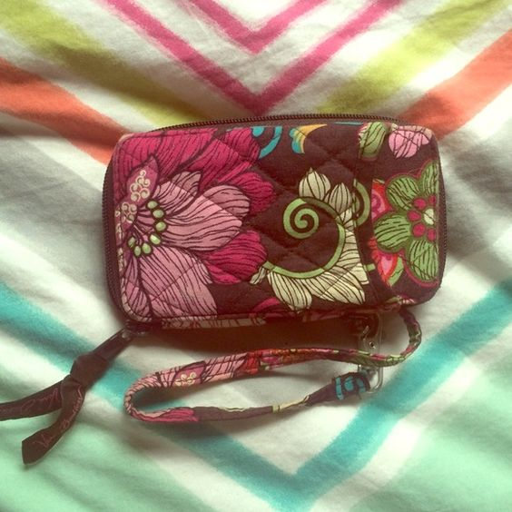 Vera Bradley wristlet Discontinued pattern. Fits iPhone 5s. In great condition! Vera Bradley Bags Clutches & Wristlets