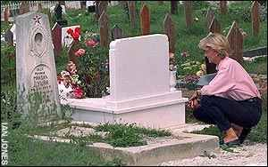 August 10, 1997: Diana, Princess of Wales visiting landmine victims' graves in Sarajevo, Bosnia.