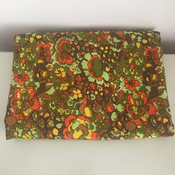 1960s floral fabric https://www.etsy.com/uk/listing/465037889/1960s-green-orange-floral-fabric-2m