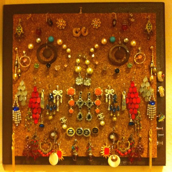 THIS IS HOW I KEEP TRACK AND ORGANIZE MY FASHION EARRINGS USING SOME FELT BOARD AND AND GLUED IT TO ANOTHER FRAME BOARD.