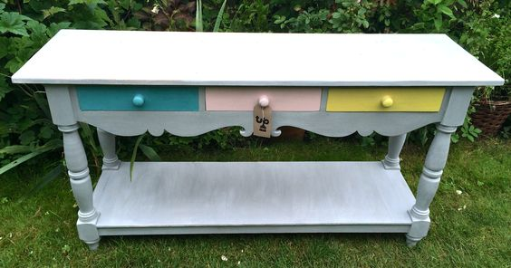 Beautiful sideboard, painted in Paris Grey with three multicoloured drawers. A good, solid piece of furniture.L1525mm x D460mm x H765mmPerfect for hallway, kitchen, bathroom… anywhere!