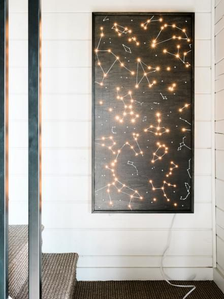 Let+the+signs+of+the+zodiac+light+up+your+walls+with+this+fun+DIY+project.+Create+modern+art+that+doubles+as+ambient+lighting+from+plywood+and+twinkle+lights.+Learn+how+to+make+this+project+>>
