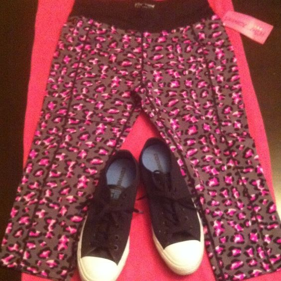 "Betsey Johnson Performance Capris Authentic Betsey Johnson Performance Capris. Grey with Pink & Violet ""Spots."" A Colorful Animal Print. 91% Nylon/9% Spandex. Black Band at the top. Has a concealed storage pouch on the Front Right. Has a Betsey Heart Logo on the Center Back. Black Threads Trim all of the Seams. Made to fit close like Leggings. Brand New. Excellent Condition. No Trades. Betsey Johnson Pants Capris"