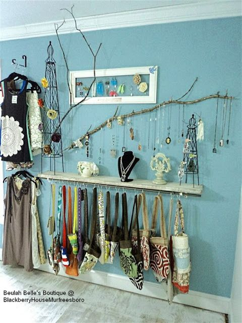 **I love the use of the hooks for bags and purses under the shelf.  Also the branch is a really fun earthy way to display stuff.