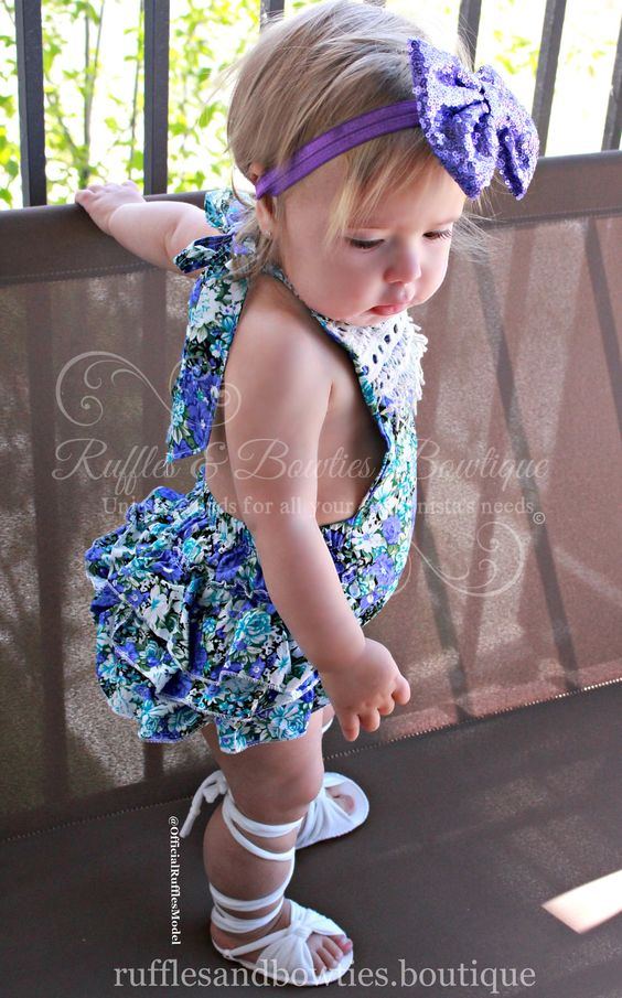 This adorable romper, is as sweet as can be, with a delicate floral print. Have fun with this one, they can wear them on there birthdays, holidays or a special